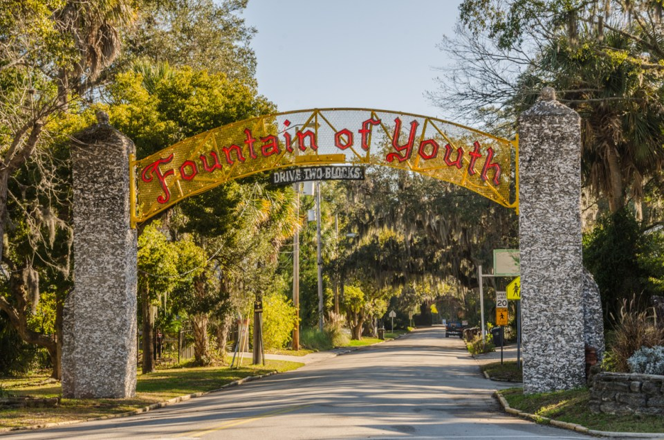 Red sign on yellow background for historic Fountain of Youth in St. Augustine Florida