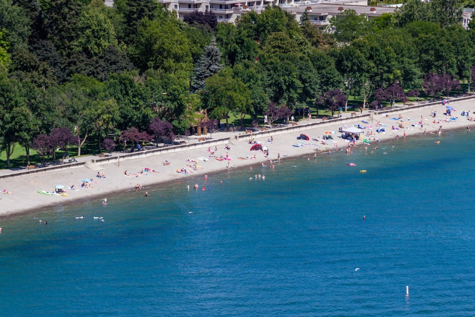 Aerial view of the beach with families enjoying the sunshine and lake in Coeur d' Alene Idaho.