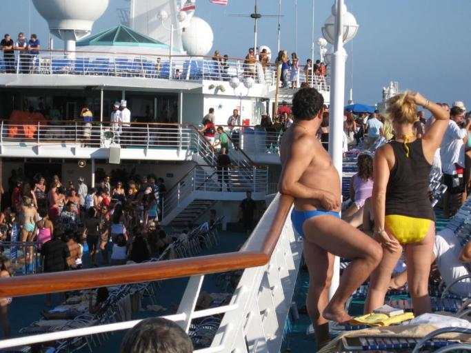 People partying on a cruise ship, including man in magic speedo.