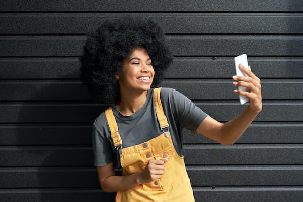 Social media user takes photo to post on social profile