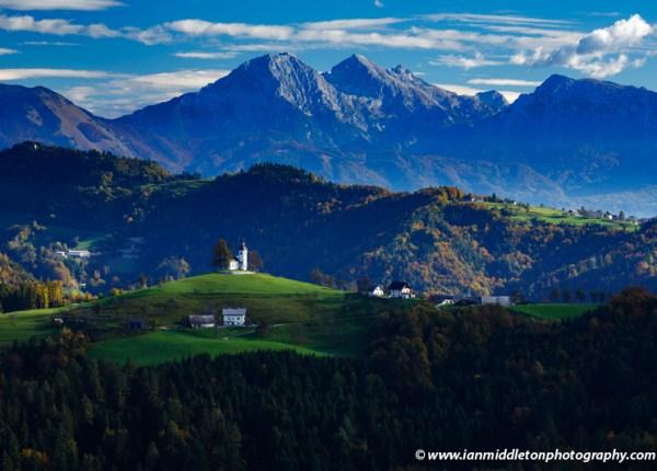 View from Rantovše hill across to Sveti Tomaz nad Praprotnim (church of Saint Thomas) in the Skofja Loka hills, Slovenia.