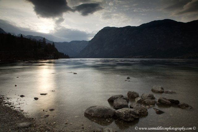 The beautiful Lake Bohinj at dusk, Triglav National Park, Slovenia. This is the largest natural permanent lake in Slovenia situated in a glacial hollow of a dead end valley. The lake has many moods and no matter what the time of year, never fails to produce stunning scenes from all angles.