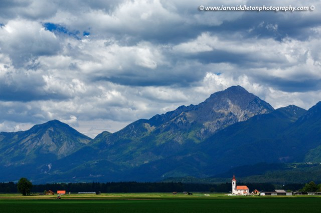 View of the the church of saint John in the shadow of Storzic mountain, Brnik, near the Ljubljana airport, Slovenia.