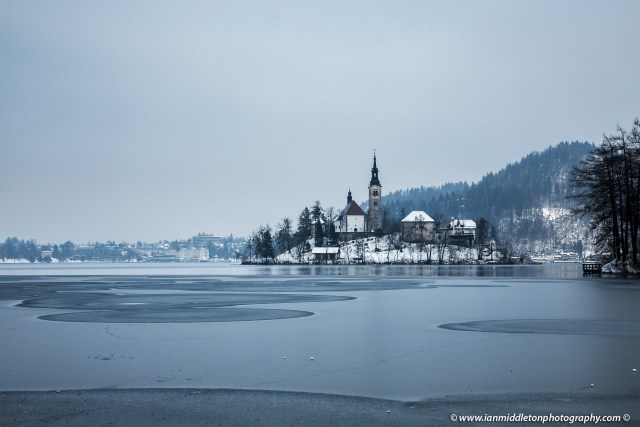 Ice circles on a frozen Lake Bled, Slovenia. The western side of the lake is slightly frozen after the Siberian storm, known as the Beast from the East, brought freezing temperatures across Europe late February.