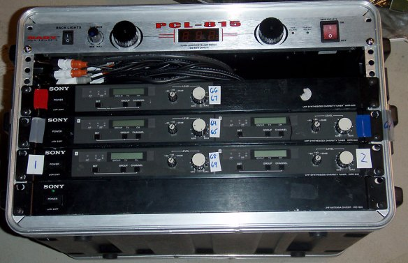 Five Sony receivers mounted for external Mackie mixing for live audience show.