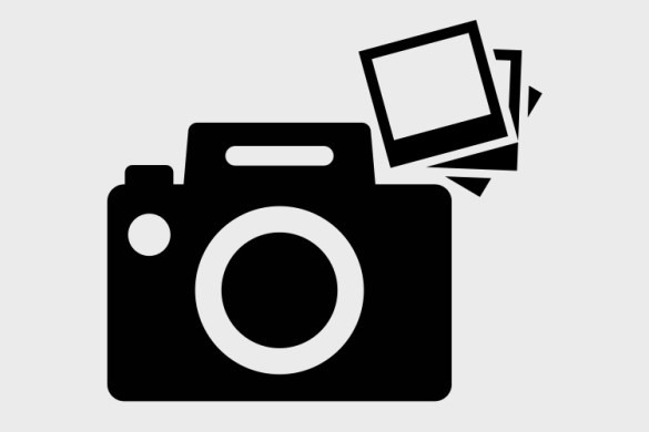 camera with polaroids in vector