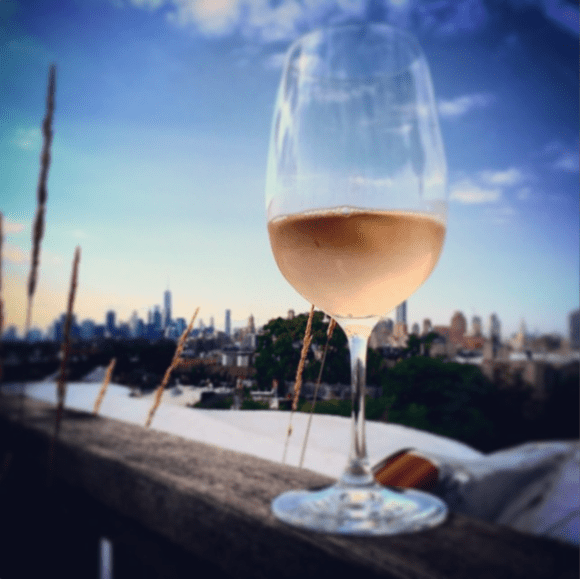 A glass of rose on the roof in Brooklyn, NY