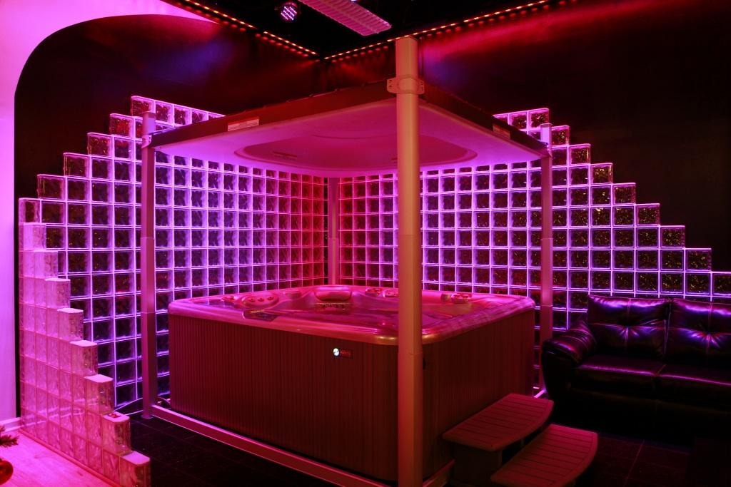 Glass Block Wall with Modern Chauvet LED Lighting in a