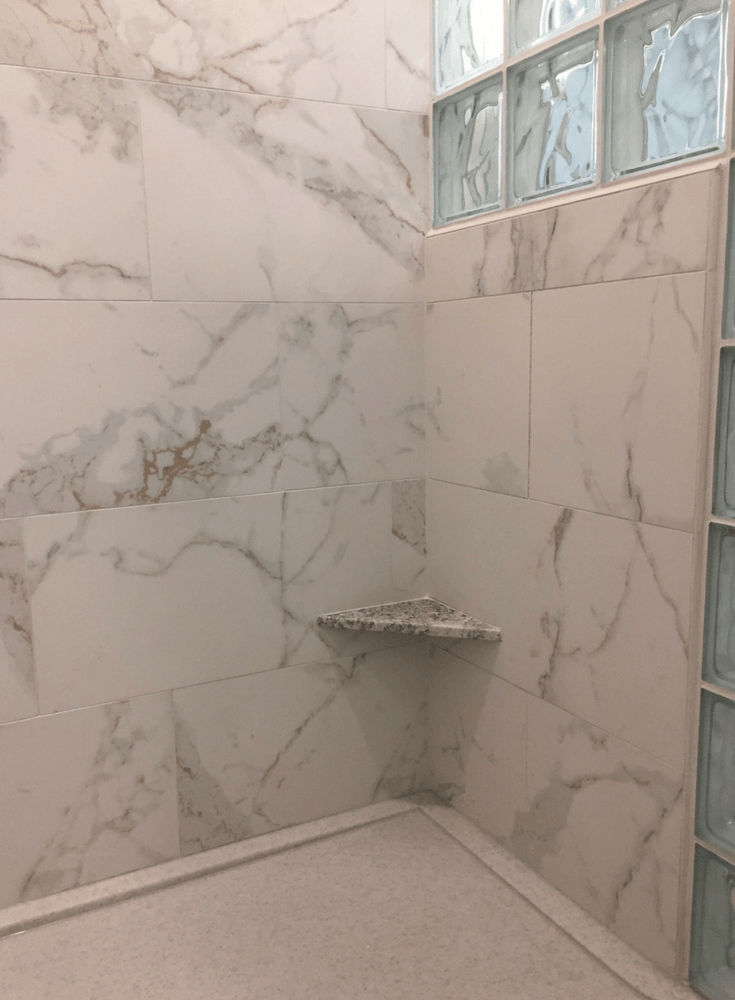 shower wall panels vs tile