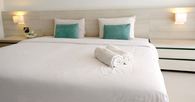 White linen bed in hotel room