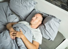 Man sleeping on his back