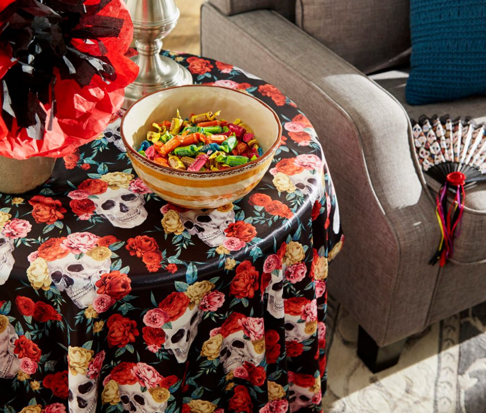 dia de los muertos end table decor idea featuring brightly colored candies