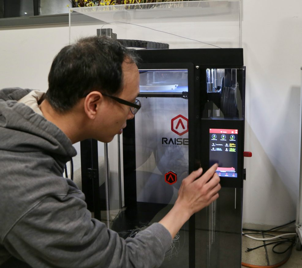 Our 3D Project Modeler, Allen Yau, uses a 3D printer to produce face shields for healthcare workers during COVID-19.