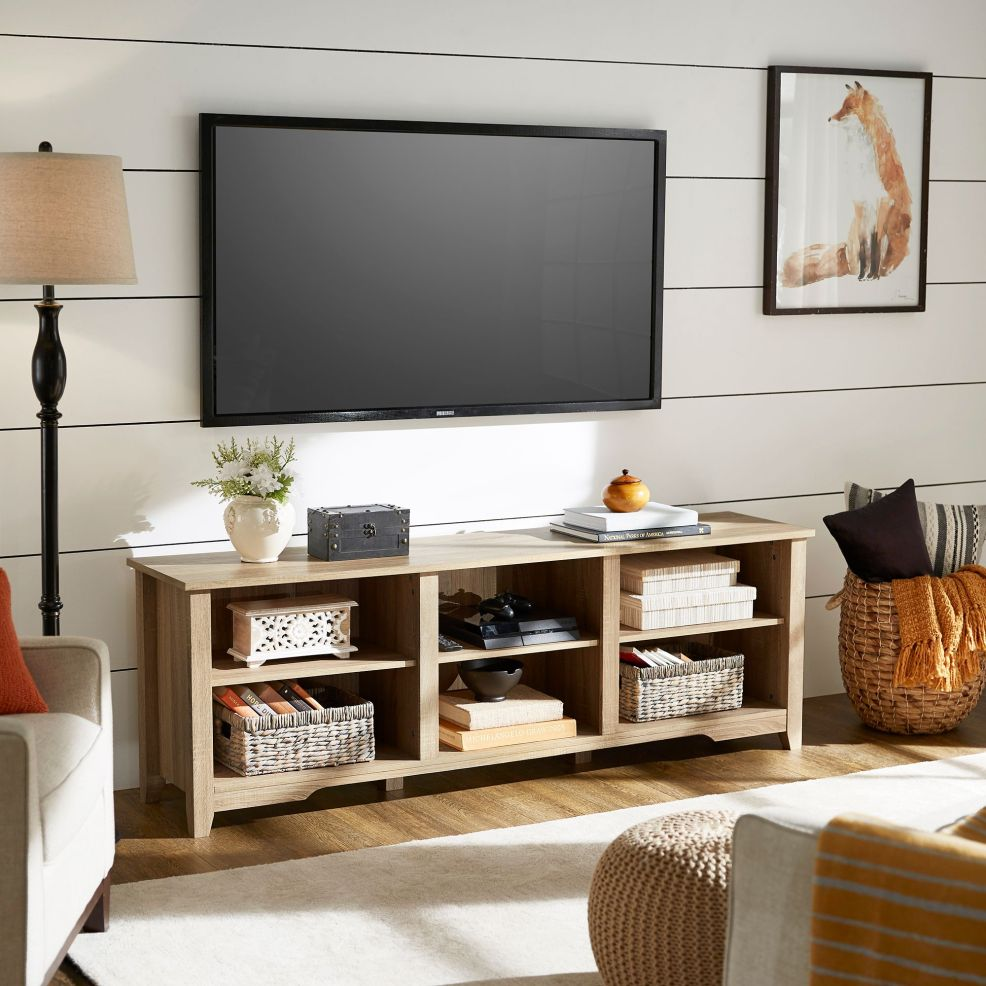 This TV stand is at the perfect height. Not too high if you want to mount your TV to the wall, and not too low if you want to set your TV directly on top of the stand. A light oak finish offers a natural look. Six wide cubbies are available to host game consoles, books, DVDs, etc.
