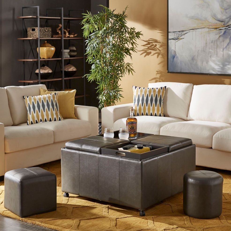 This multipurpose leather ottoman is one of our best man cave ideas. There are four square cushions atop this ottoman and each one can be lifted and reversed to transform into a tray for setting drinks down. By removing the tops, a large interior storage compartment is revealed. 2 square cubes and 2 round cylinders are also upholstered in matching leather and provide extra spots to sit in your man cave.