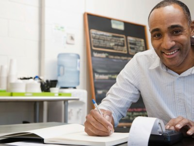 Man working on Accounts Remotely in Cafe