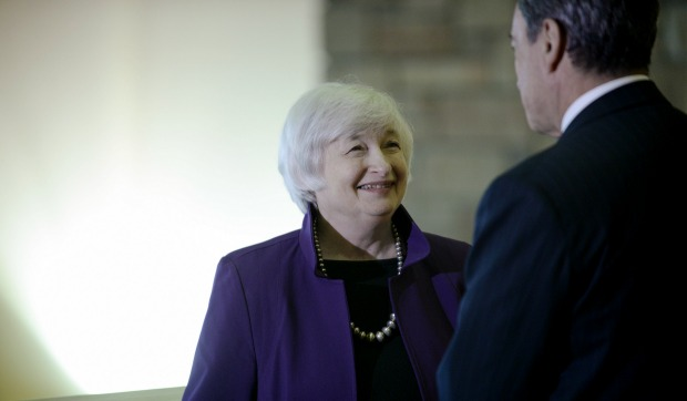Federal Reserve Chair Janet Yellen visits with Mario Draghi, president of the European Central Bank, at Jackson Lake Lodge during the 2014 Federal Reserve Bank of Kansas City Economic Symposium Friday, Aug. 22, 2014, in Jackson Hole, Wyo.