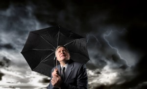 businessman-umbrella-storm-shutterstock