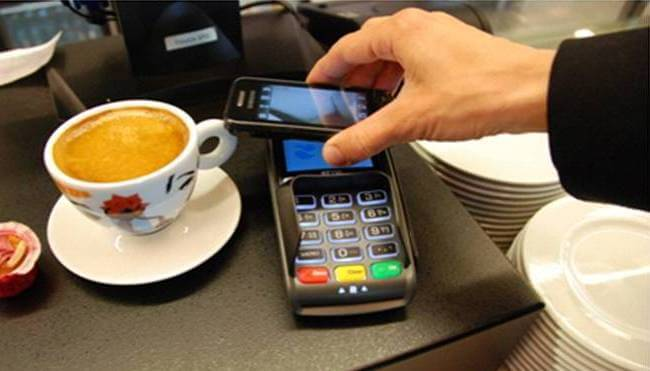 Person using NFC payment on smartphone