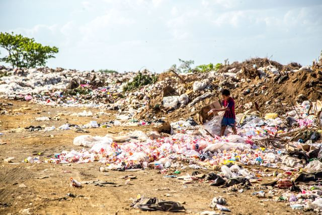 Let's recycle responsibly to prevent our waste from being dumped in other parts of the world. Photo by Hermes Rivera on Unsplash.