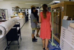 Cindi and Esther are guided through JANM's artifacts by Collections  Manager, Maggie Wetherbee.