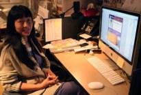 Cindi, JANM's 2013 production intern, designing a event flyer.