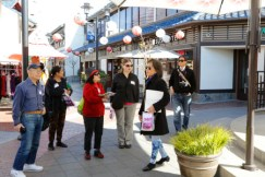 JANM volunteer, Roxana, leads an enthusiastic group through Little Tokyo on an Edible Adventure earlier this year.