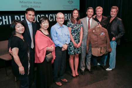 "L to R: Aly Morita, Ralph Macchio, JANM Trustee Wendy Shiba, director John Avildsen, JANM New Leadership Advisory Council president Kira Teshima, JANM President and CEO Greg Kimura (holding ""Mr. Miyagi's"" WWII uniform), Billy Zabka, and Martin Kove. Photo: Russell Kitagawa."