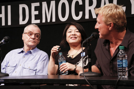 Avildsen, Morita, and Zabka share a moment during the Karate Kid panel discussion. Photo: Russell Kitagawa.