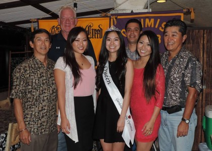Camryn Sugita, center, is crowned Miss GEO 2015. Surrounding her are four members of the GEO club, along with 2014 Nisei Week Princess Tiffany Hashimoto (left) and 2008 Nisei Week Queen Jill Hiraizumi (right).