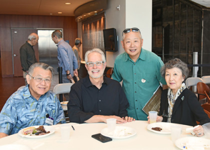 Dennis Reed (second from left) with Sadao Kimura, Alan Miyatake, and Minnie Takahashi at a special private luncheon held for family members of the photographers featured in Making Waves. Photo by Nobuyuki Okada.