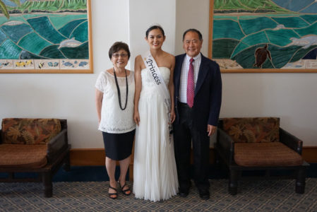 Princess Camryn Sugita with her parents at the New Otani Kaimana Beach Hotel.