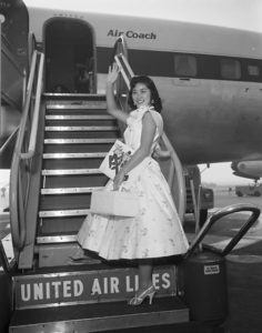 1955 Nisei Week Queen Stella Nakadate departs for Hawaii from LAX. Photo by Toyo Miyatake Studio. Japanese American National Museum, Gift of the Alan Miyatake Family.