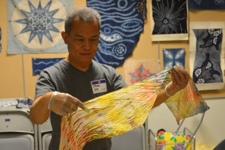 A workshop participant examines his work. Photo by Dr. Tsuneo Takasugi.