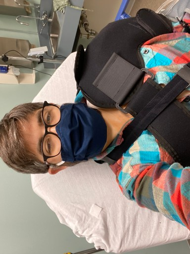 A photo of me wearing a sling and shoulder compression wrap shortly after surgery.