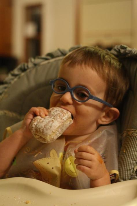 David eating a celebratory donut at home.