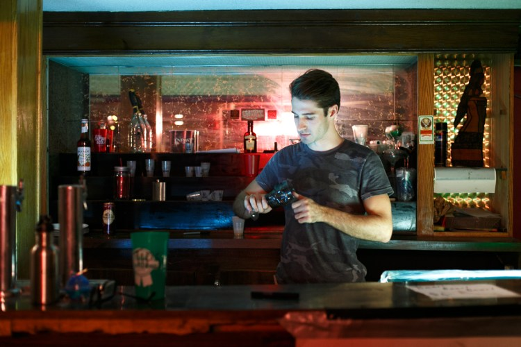 Adrian fits right in as a bartender