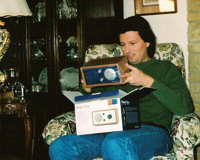 Opening a Christmas gift in my childhood home