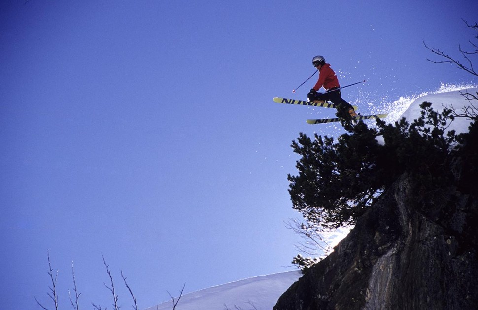 an image of a skier jumping of a cliff