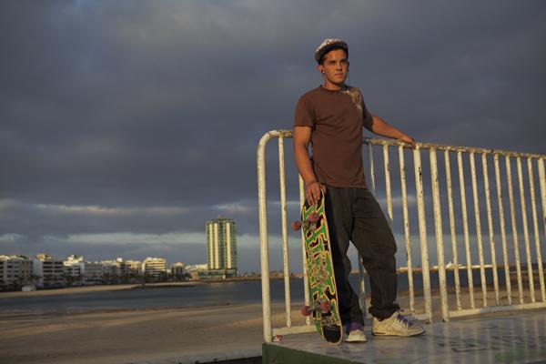 skateboarder-against-rail