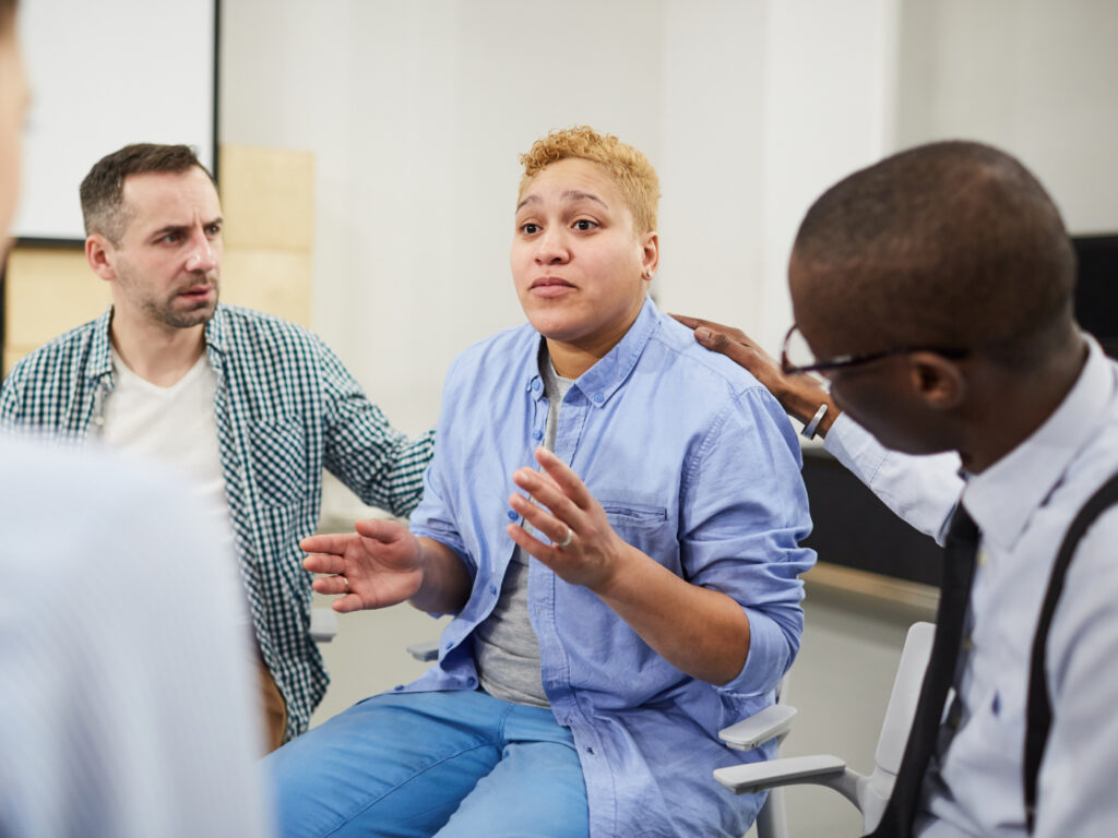 People Discussing Mental Health in a Self-Help Group