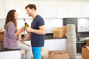 JS Realty Couple Celebrating Moving Into New Home With Champagne