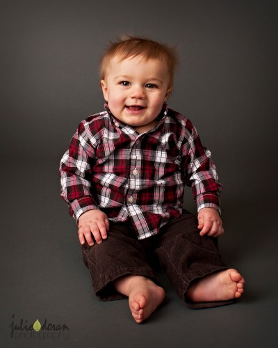 baby in plaid shirt and brown pants