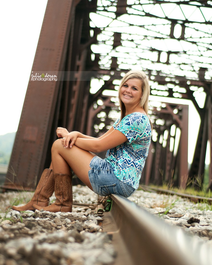 """girl sitting on railroad tracks"""