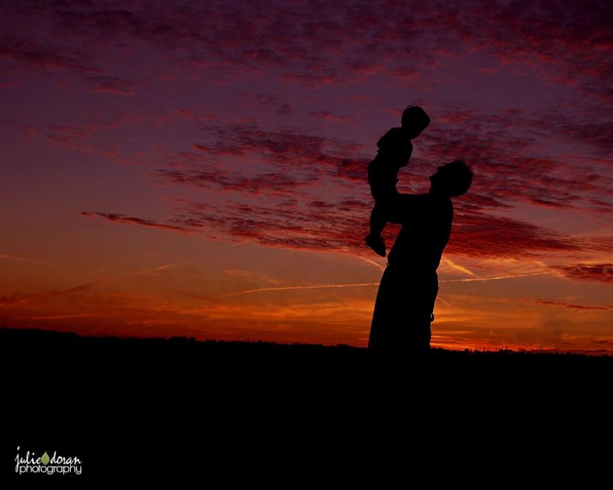 grandpa_holding_grandson_silhouette