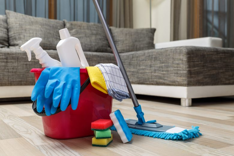 Cleaning agents in a bucket with gloves