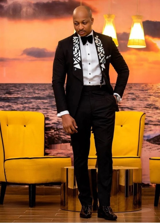 IK Ogbonna in his black suit and bow tie
