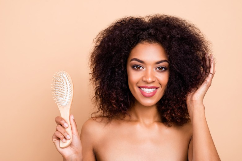 A woman holding a hair brush