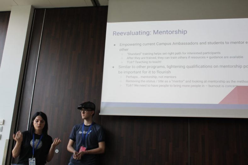 Me and Jona during our presentation on University Outreach at Fedora Flock