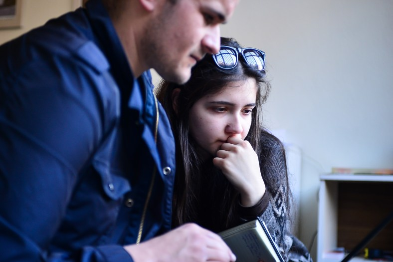 Two attendees work together on their project idea